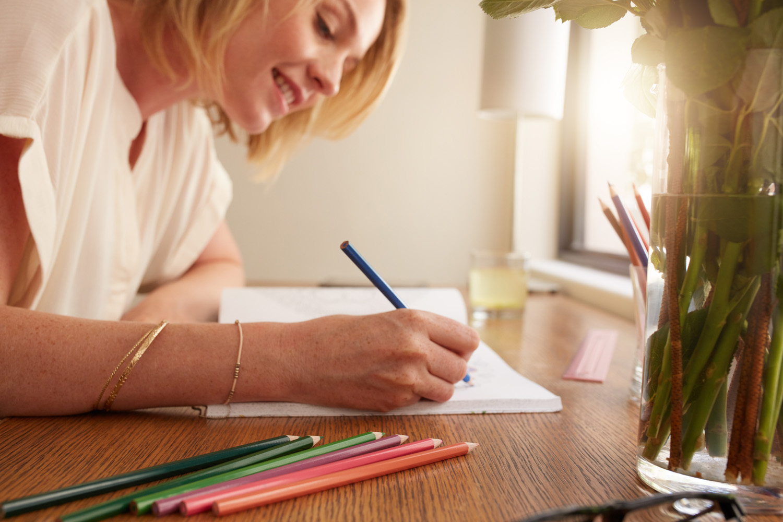 Woman enjoying benefits of adult coloring books and having fun